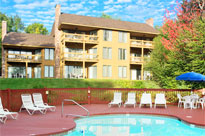 The outdoor pool on a sunny day at The Summit Resort