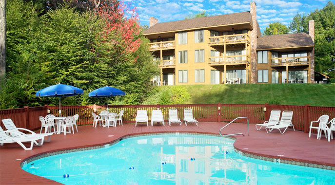 The outdoor pool deck and lounge chairs at our NH Resort